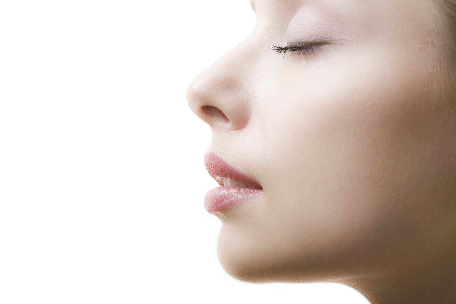 Profile of feminine face with closed eyes and make-up